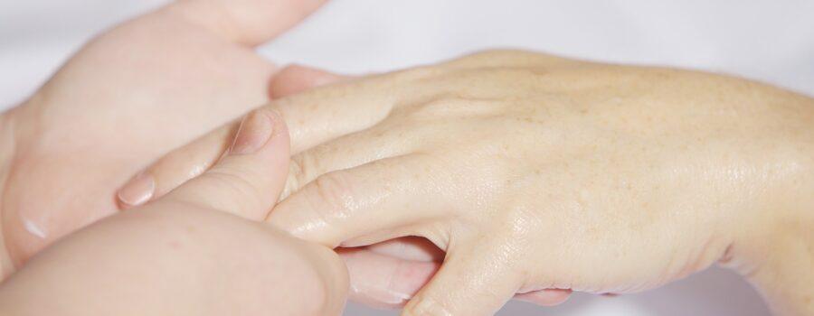 A hand massaging a hand